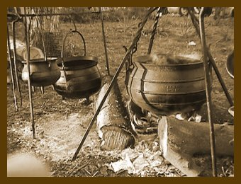 Hanging On A Cross Piece Are Two Small Bulge Pots While Six Gallon One Hangs From Fed Tripod These Sometimes Called Gypsy Kettles