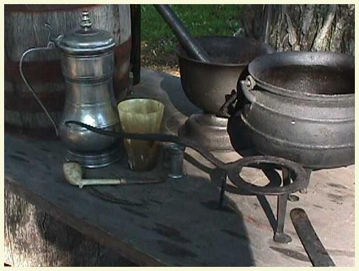 a large cast mortar u0026 pestle a small forged trivet and a small cast bulge pot